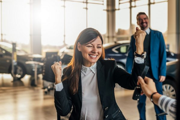Woman celebrating car purchase